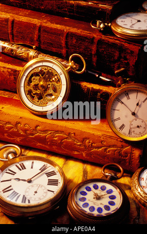 old antique books and pocket watches - Stock Photo