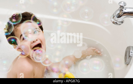 Baby in a bubble bath - Stock Photo