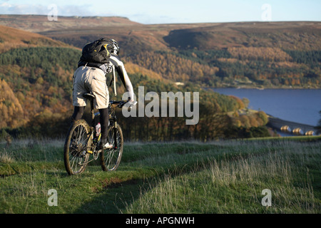 Mountain Biker rides in Peak District. England. UK - Stock Photo