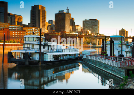 View of St Paul Minnesota skyline and tugboat - Stock Photo