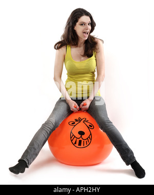 Young female on a space hooper - Stockfoto