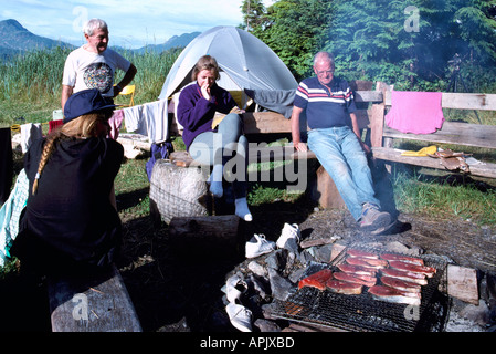 Barbecue, barbecuing / grilling Salmon on Bbq Grill at Wilderness Campsite, Pacific West Coast, BC, British Columbia, - Stock Photo