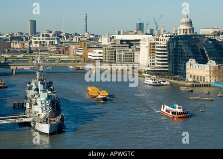 London semi aerial view River Thames HMS Belfast cruiser floating museum moored in pool of London City & West End - Stock Photo