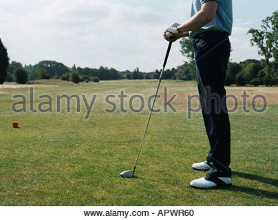 Man on a golf course - Stock Photo