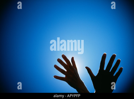 FEMALE HANDS REACHING FOR THE SKY - Stock Photo
