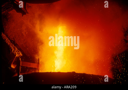 Molten steel being poured into a Bessamer converter in a steel foundry - Stock Photo