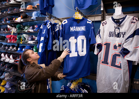 A woman shops for Football jerseys prior to the XLII Superbowl in 2008 between the New York Giants and the New England - Stock Photo