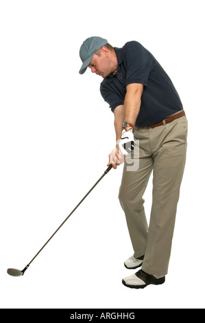 This golf image demonstrates a perfect example of keeping your head still and your eye on the ball when taking a - Stock Photo