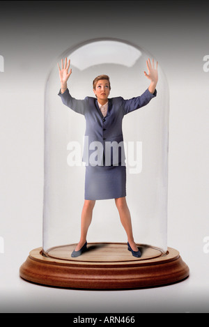 businesswoman trapped in glass bell jar - Stock Photo