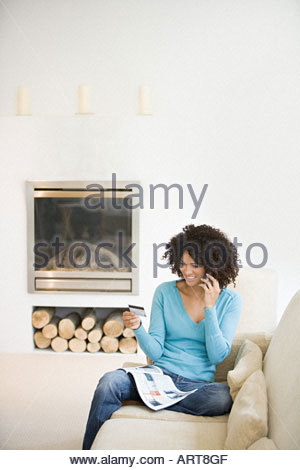 Woman shopping over the telephone - Stock Photo