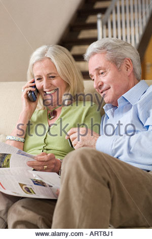 Senior couple looking at a brochure - Stock Photo