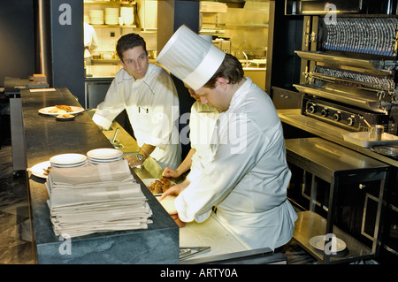 PARIS France, Male 'French Chefs' Preparing Meals in Contemporary 'French Restaurant' 'Gourmet Chef' Travel - Stock Photo