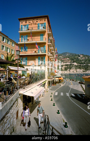 The Welcome Hotel at Villefranche-sur-mer overlooking the narrow road around the picturesque harbour- near Nice, - Stock Photo