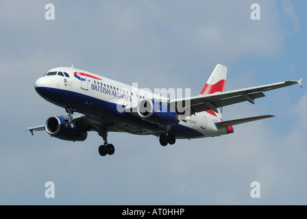 A British Airways Airbus on final approach to Heathrow Airport in London - Stock Photo