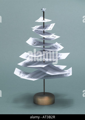 A receipt tree with a silver Christmas star on top - Stock Photo