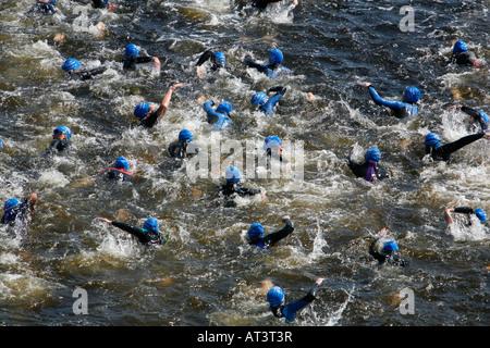 Swimmers start the 2007 London Triathlon in Royal Victoria Dock, London - Stock Photo