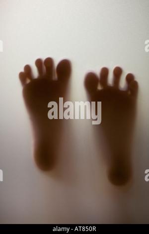 Shadow figure Little boy's feet - Stock Photo