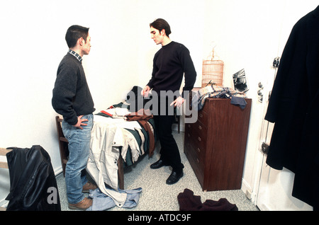 French Male Teenagers Roommates Boys Arguing in Bedroom, One Asian, one Caucasian, Cramped People inside Home 'Flat - Stock Photo