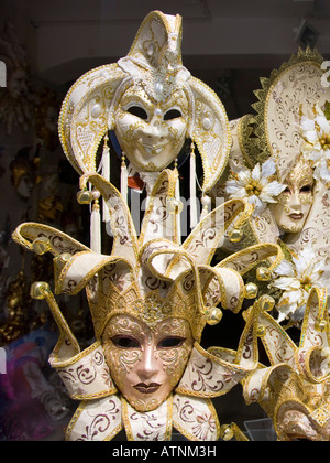 Venice, Veneto, Italy. Superbly crafted carnival masks on display in up-market shop window. - Stock Photo