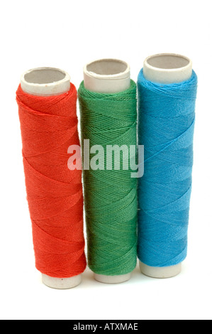 3 three reels of Red green blue RGB colours of stitching threads on white background - Stock Photo