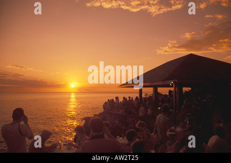 Jamaica Negril Sunset at Rick s Cafe, famous sunset celebration attraction. - Stock Photo