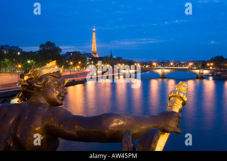 France Paris Eiffel Tower view from Pont Alexandre III at dusk along the river Seine - Stock Photo
