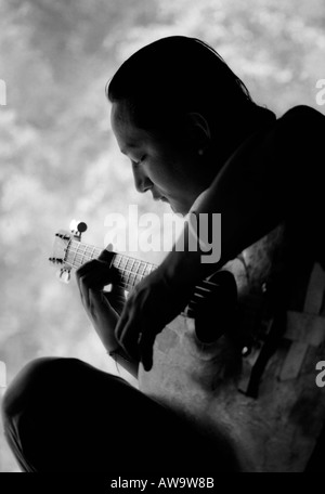 Young nepali guitar player - Stock Photo