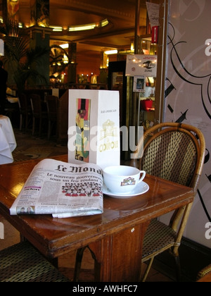 Table in famous cafe restaurant La Couple Montpartnasse Paris France - Stock Photo