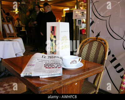 Table in famous cafe restaurant La Coupole Montpartnasse Paris France - Stock Photo