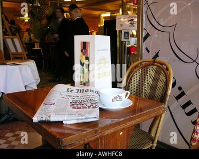 Table in famous cafe restaurant La Coupole Montpartnasse Paris France - Stock Photo
