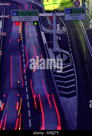 Blurred light trails on busy street, France - Stockfoto