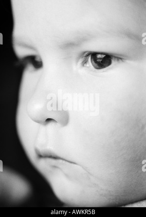 Child's face, close-up, b&w - Stock Photo