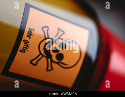 Close-up of poison bottle with skull and crossbones - Stock Photo