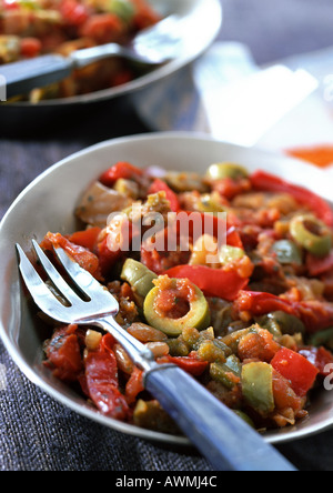 Piperade (Basque dish made with tomatoes, bell peppers and olives), close-up - Stock Photo