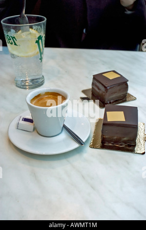 Paris France, French Luxury 'Chocolate Cakes' and Espresso Coffee, Store, 'Pierre Hermé' Marble Table, detail, Pastries - Stock Photo
