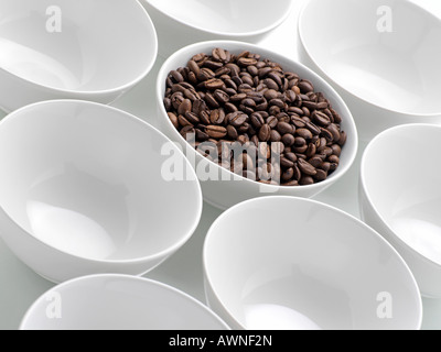 Coffee beans in a bowl - Stock Photo