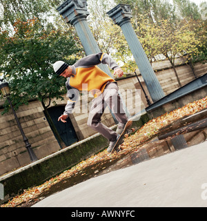 Young man in mid-air on skateboard - Stock Photo