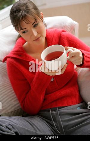 Young girl herbal tea - Stock Photo