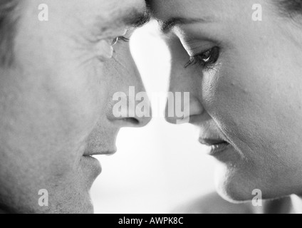 Couple face to face, close-up - Stock Photo