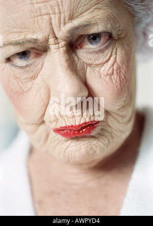 Elderly woman frowning, portrait, close-up - Stock Photo