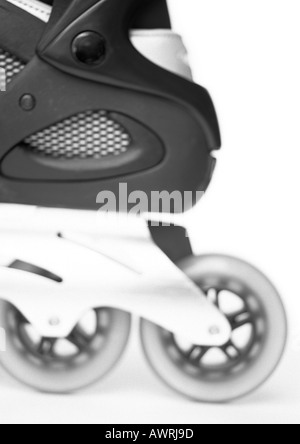 In-line skate, side view, close-up, b&w. - Stockfoto