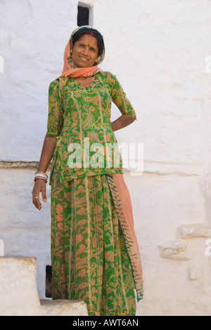 Portrait of a Rajasthani woman standing on a staircase in Jaisalmer, India. - Stock Photo