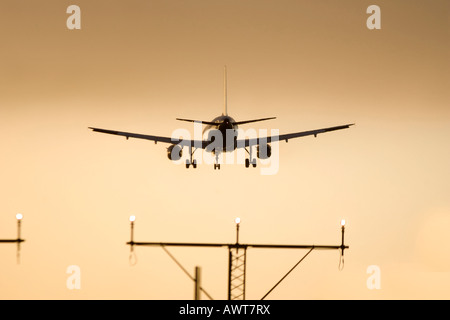Airliner lands at Heathrow Airport London England UK - Stock Photo