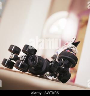 Pair of roller skates on floor - Stockfoto