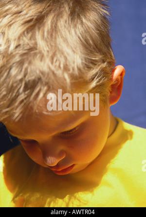 Little boy looking down, portrait - Stock Photo