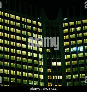 Office buildings lit up at night, exterior - Stock Photo