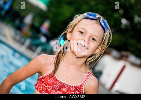 poolside girl with goggles - Stock Photo