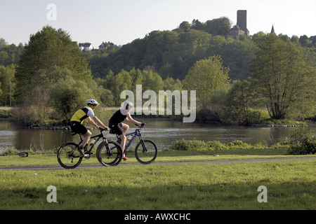 mountainbiker at bicycle lane, castle Blankenstein in background, Germany, North Rhine-Westphalia, Ruhr Area, Bochum - Stock Photo