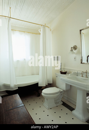 White Shower Curtains On Freestanding Wooden Panelled Bath In Ochre Stock Photo Royalty Free