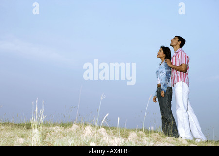 Side profile of a young couple dreaming in a park - Stock Photo